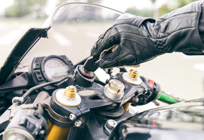 Motorcycle ignition action. Pilot inserting the key and starting the engine